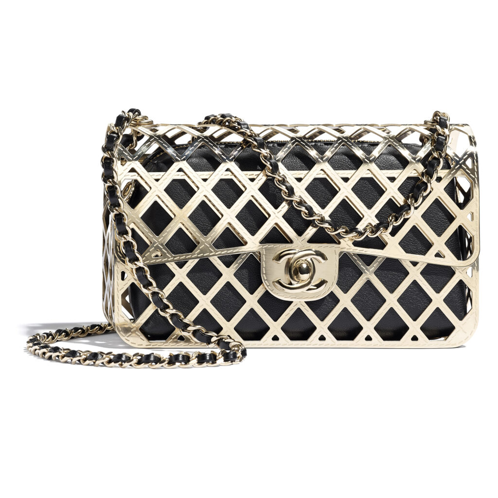 chanel Gold and black bag in brass and leather